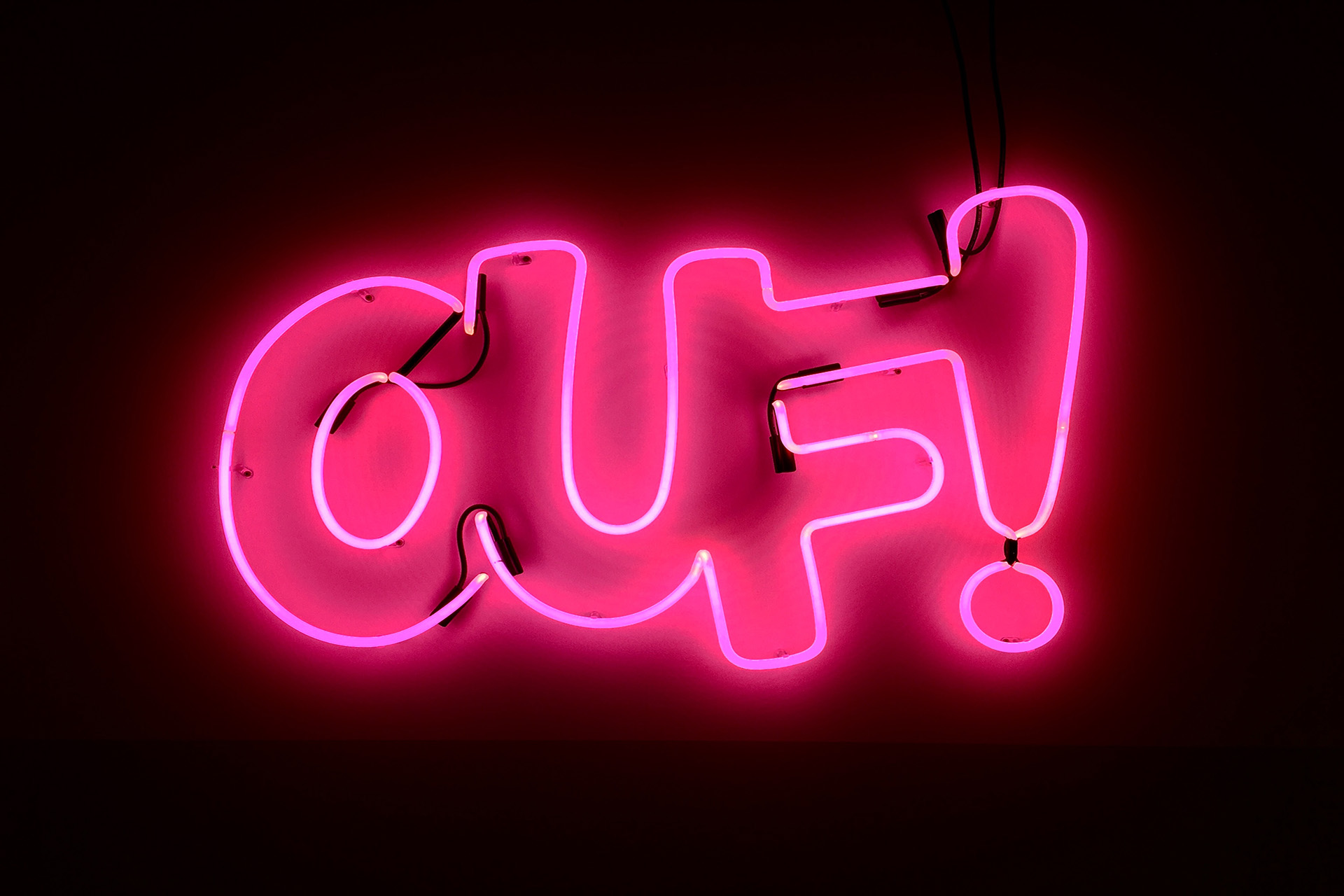"neon sign saying ""ouf!"""