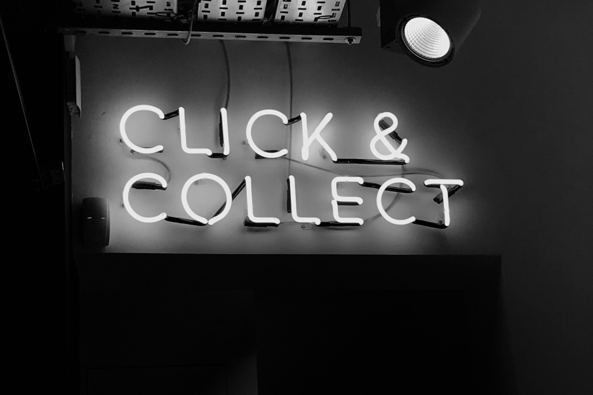 Neon sign that reads: Click & Collect