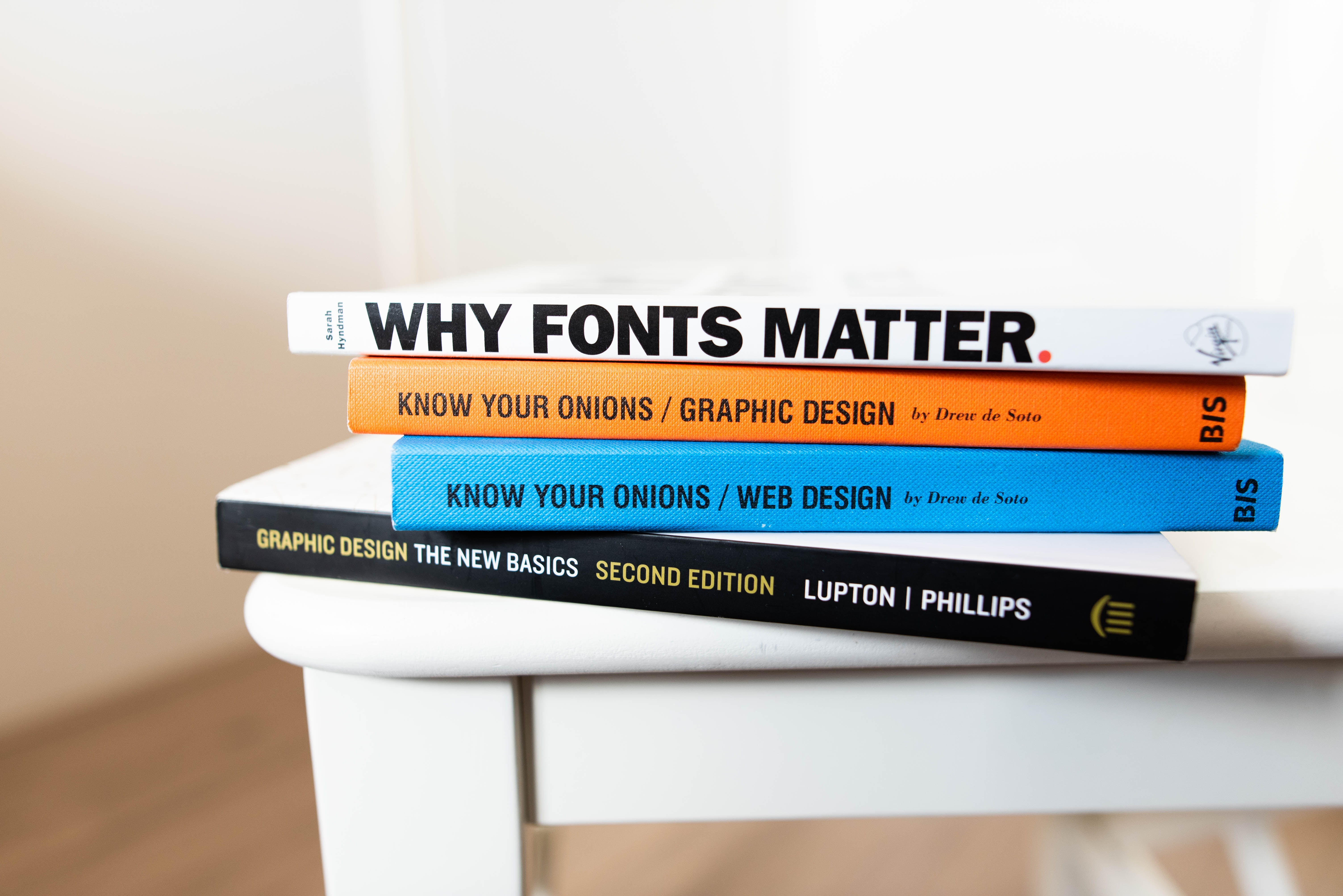 Stack of books on graphic design and fonts