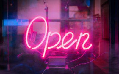 """Neon """"open"""" sign in window"""
